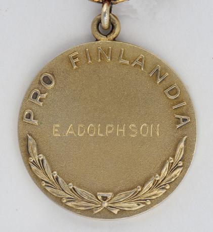 Pro Finlandia -mitalin kääntöpuoli